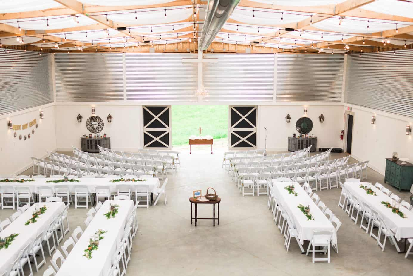 White tables in the Grand White Barn